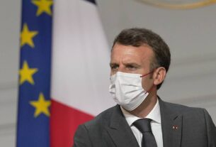 In France, angry protests, rising infections and record vaccinations