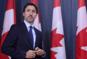 Canada's Trudeau, trailing in polls, defends early election call